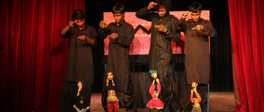 The puppeteers proudly hold their puppets- the Anarkali right before the performance.